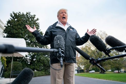 SITE VISIT: US President Donald Trump speaks to the media before departing the White House for California, where he viewed damage from that state's recent deadly wildfires. Photograph:  Jim Lo Scalzo/EPA