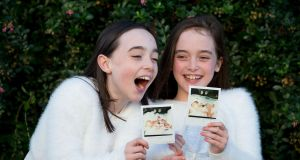 Twins Crea and Kerry Meehan aged 10 from Ballyfermot, Dublin with photos of themselves as premature babies. Photograph: Tom Honan