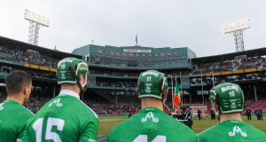 Limerick players stand for the national anthem before the Fenway  Classic  final match against Cork  at Fenway Park. Photograph: Piaras Ó Mídheach/Sportsfile.