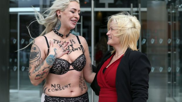 Leona O'Callaghan (right) hugs consent protester Stacie Ellen Murphy outside the Central Criminal Court in Dublin on Monday after Patrick O'Dea (51) of Pike Avenue, Limerick, was sentenced to 17 years for her rape and sexual assault on dates in 1994 and 1995. Photograph: Laura Hutton/Collins