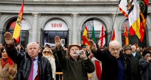 Supporters of Spain's late dictator Francisco Franco give fascist salutes at Madrid's Plaza de Oriente. Photograph: Paul Hanna