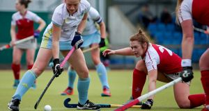 UCD's Bethany Barr in action with Stephanie Thompson of Pegasus.  Barr is among the four new players to be featured in the Ireland squad for a five-day training camp in Spain. Photograph: Laszlo Geczo/Inpho