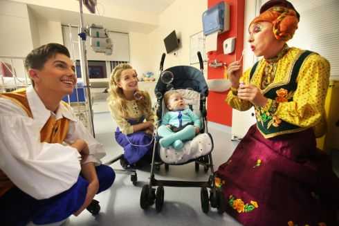 "BUBBLING OVER: Granny ""Hurdy Gurdy"" (Joe Conlan, left), Rosie (Ciara Lyons) and Robin (Adam Isla O'Brien) from the cast of The Snow Queen, meet Lewis Long (7 months) from Traynor Road, Dublin, at Our Lady's Children's Hospital, Crumlin. They paid a special visit ahead of the panto's opening this Sunday at the Gaiety in Dublin. Photograph: Leon Farrell/Photocall Ireland"