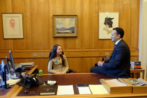 KIDS TAKE OVER: Aoife Murphy, from Co Westmeath, winner of Unicef's #KidsTakeOver competition, gets to sit behind Taoiseach Leo Varadkar's desk and make her views known, at Government Buildings, Dublin. Photograph: Dara Mac Donaill/The Irish Times