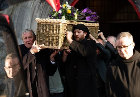 FILIAL DUTY: Cian, son of late De Dannan member Alec Finn, carrying his father's coffin at the Collegiate Church of St Nicholas in Galway City. Photograph: Andrew Downes/Xposure for The Irish Times