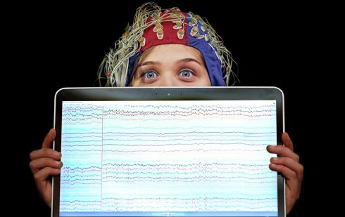 BRAIN-POWERED: Olga Brych, clinical data scientist, with a display of EEG traces of electrical activity in her brain at the launch of the FutureNeuro SFI Research Centre at the RCSI in Dublin. FutureNeuro is a €13.6 million centre that aims to translate breakthroughs in understanding of brain structure and function to transform experiences of neurological diseases. Photograph: Julien Behal Photography