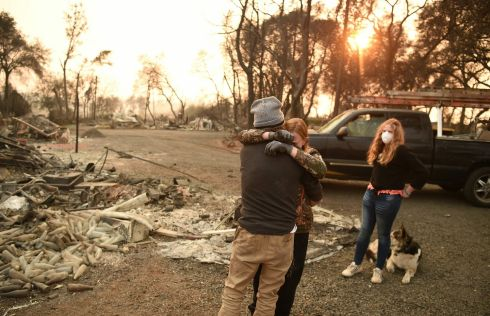 BURNT OUT: Kimberly Spainhower hugs her husband Ryan Spainhower while their daughter Chloe (13), looks on at the burned remains of their home in Paradise, California. Photograph: Josh Edelson/AFP/AFP/Getty Images