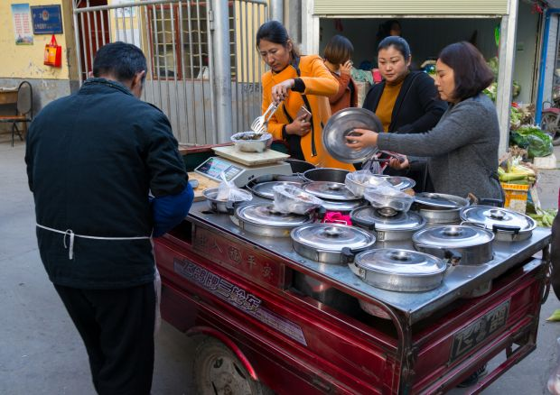 A street food vendor Lanzhou, China on November 2nd Photograph: Eric Lafforgue/Art In All Of Us/Corbis/Getty
