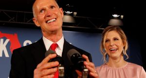 Republican US Senate candidate Rick Scott  with his daughter Alison at his midterm election night party in Naples, Florida, on November 6th. Mr Scott took 50.05 per cent of the recounted vote. Photograph: Joe Skipper/Reuters