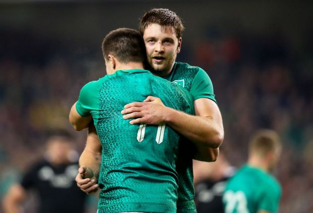 Iain Henderson and Jacob Stockdale embrace after the Saturday's win over the All Blacks Photograph: Oisin Keniry/INPHO