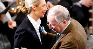 Alice Weidel of Alternative für Deutschland is greeted by Alexander Gauland   in Berlin's  Reichstag building   to mark National Mourning Day, on Sunday. She faces questions over donations for her Bundestag campaign last year. Photograph: Fabrizio Bensch/Reuters