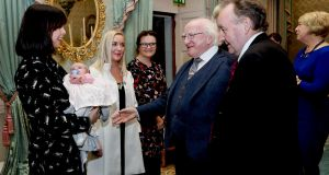 The President, Michael D  Higgins meets   the newest member of the Humanist Association of Ireland, Zoe, and her mother, Selina Campbell,  at the association's 25th anniversary  celebrations. Photograph:  Maxwell's