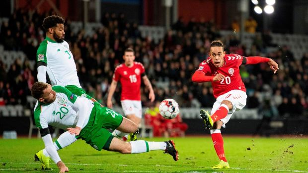 Denmark's Yussuf Poulsen has a shot blocked by Richard Keogh. Photo: Bo Amstrup/Getty Images