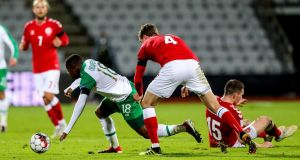 Ireland's Michael Obafemi and Andreas Bjelland of Denmark in action in Aarhus. Photograph: Ryan Byrne/Inpho