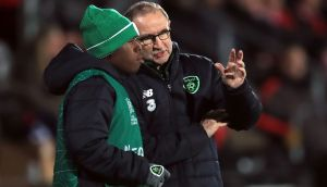 Republic of Ireland manager Martin O'Neill speaks to Michael Obafemi before the 18 year-old makes his debut against Denmark. Photograph: PA
