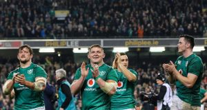 Andrew Porter, Tadhg Furlong and James Ryan celebrate after Ireland's win over the All Blacks. Photograph: Gary Carr/Inpho
