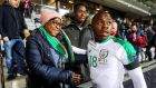 Michael Obafemi with his mother Bola and brother Affy following his international debut away to Denmark. Photograph: Ryan Byrne/Inpho