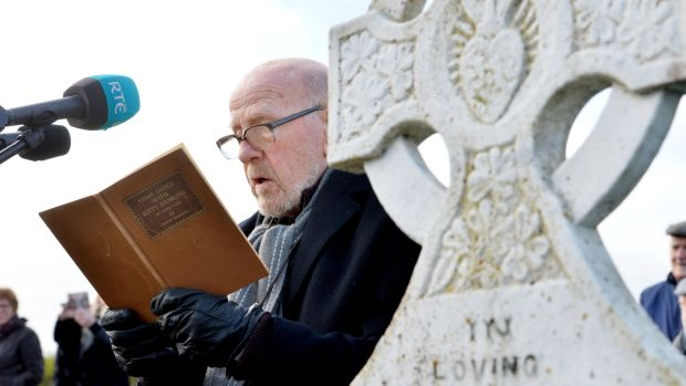 Eugene McCabe reads Come Dance with Kitty Stobling at the grave of Patrick Kavanagh in Inniskeen, Co Monaghan last November as part of a tribute to mark the 50th anniversary of the poet's death. Photograph: Alan Betson
