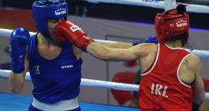Kellie Harrington beat Canada's Caroline Veyre in a unanimous decision to reach the semi-finals in India. Photograph: Money Sharma/AFP/Getty