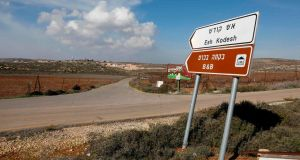 A road sign points towards an Airbnb apartment near the Jewish settlement of Shilo and the Palestinian village of Qusra in the occupied West Bank. Photograph:  Menahem Kahana/AFP/Getty Images
