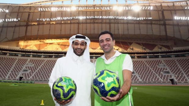 Hassan Al Thawadi, the Secretary General of the Qatar's Supreme Committee for Delivery and Legacy (SC) poses with former Spanish footballer and World Cup 2022 ambassador Xavi during a presentation at the at Khalifa International Stadium in Doha, Qatar. Photo: Alex Grimm/Bongarts/Getty Images