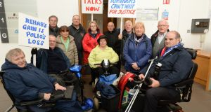 Members of the Justice for Polio Survivors campaign occupying Rehab's Park West offices in Dublin. Photograph: Dara Mac Dónaill/The Irish Times