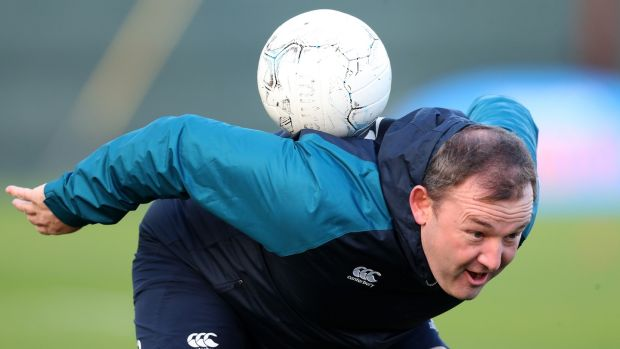 Kicking coach Richie Murphy tries some skils with the round ball. Photo: Billy Stickland/Inpho