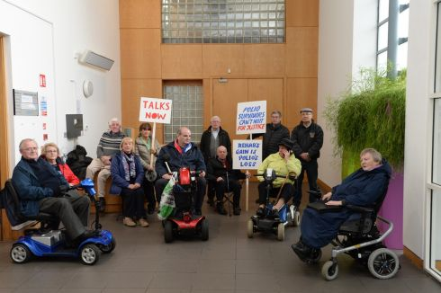 POLIO SURVIVORS: Members of the Justice for Polio Survivors campaign group occupy Rehab's Park West offices in Dublin over what they said was its refusal to provide services or support to people with disabilities arising from polio. Photograph: Dara Mac Donaill/The Irish Times