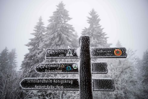ICY PATHS: A signpost to hiking trails gets a dusting of snow in Sankt Andreasberg, near Braunlage, central Germany. Photograph: Swen Pfortner/AFP/Getty Images