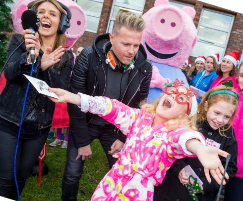 FESTIVE FROLICS: Grace Braiden (7), and her sister Jade (8), from Saggart, Co Dublin, with 2FM presenters Nicky Byrne and Jenny Greene, turn on the Christmas lights at Our Lady's Children's Hospital Crumlin as part of the CMRF Crumlin #WhateverItTakes campaign. Photograph: Conor Healy/Picture it Photography