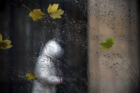 HEAVY WEATHER: Rain and leaves slide across a window on an inclement day in Pamplona, Spain. Photograph: Inaki Porto/EPA