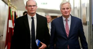 Minister for Foreign Affairs Simon Coveney and the EU chief Brexit negotiator Michel Barnier in Brussels, Belgium, in March. File photograph:  Olivier Hoslet/Pool via Reuters