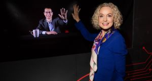 Vodafone Ireland chief executive Anne O'Leary high fives interim technology director Max Gasparroni during what is believed to be the first Irish international holographic call. Photograph: Naoise Culhane