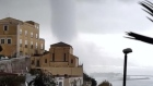 Massive waterspout looms over Italian coastal town