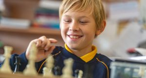 Michal Bogdanovich plays chess in Blarney Street CBS primary school in Cork.  Photograph: Michael MacSweeney/Provision