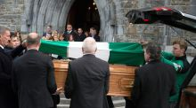 Kerry footballer James O'Donoghue places The Legion Flag on GAA broadcaster Weeshie Fogarty's coffin at his funeral in St Mary's Cathedral, Killarney on Wednesday.Photo: Don MacMonagle