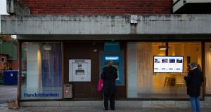 An ATM in Sandviken, Sweden. Cash is disappearing in the country faster than anyone thought it would. Photograph: The New York Times
