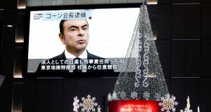 Street monitor showing a news report about arrest of Nissan chairman Carlos Ghosn  in Tokyo,  November 21st. Photograph: Reuters/Toru Hanai