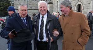 Presenters Joe Duffy and Ronan Collins, and singer Tony Kenny pictured at the funeral of  Sonny Knowles at St Agnes's Church, Crumlin, Dublin.  Photograph: Collins.