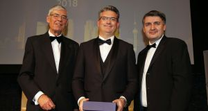 Edmond Scanlon (centre) receives the lifetime achievement award on behalf of Kerry Group at the Asia Matters Business Awards in Dublin, presented by Asia Matters chairman Alan Dukes (left) and Martin Murray, its executive director. Photograph: Nick Bradshaw