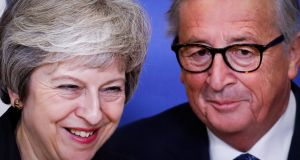 British prime minister Theresa May with  European Commission president Jean-Claude Juncker in Brussels.  Photograph: Olivier Hoslet/EPA