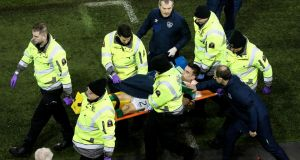 Martin O'Neill speaks to Seamus Coleman as he is stretchered off after breaking his leg during Ireland's 2018 World Cup qualifier against Wales. Photo: Tommy Dickson/Inpho