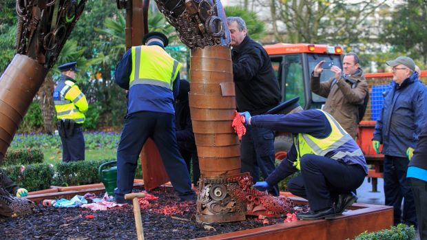 Attempts to clean the vandalised Hautings Soldier sculpture are underway in St Stephens Green, Dublin. Photograph: Gareth Chaney/Collins