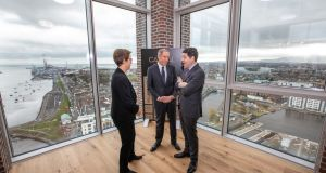 From left: Kennedy Wilson's Capital Dock   Mary Ricks, the company's chairman William J. McMorrow and Minister for Finance  Paschal Donohoe   inspect the company's new Capital Dock scheme.