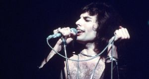 Circa 1975: Freddie Mercury in concert during the Queen's British tour. Photograph: Keystone/Getty Images.