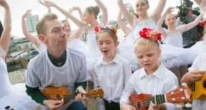 Host Ryan Tubridy and the School of Uke ukulele orchestra from east Cork during  auditions for the Late Late Toy Show in Cork. Photograph: Daragh McSweeney/Provision