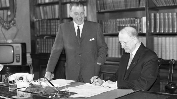 Taoiseach Seán Lemass and Éamon de Valera signing the proclamation to dissolve Dáil Éireann in 1965. Photograph: Independent News And Media/Getty