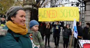 Kate Minnock, teacher with her daughter Fiadh joined students, teachers and parents from North Wicklow Educate Together Secondary School protest outside Leinster House, Dublin. Photograph: Dara Mac Dónaill / The Irish Times