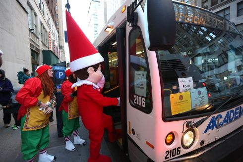 ELF ON A BUS: A person dressed as an elf boards a bus before the start of the annual Macy's Thanksgiving Day Parade in Manhattan, New York on November 22nd.  Photograph: Earl Wilson/The New York Times