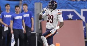 Eddie Jackson  of the Chicago Bears celebrates his touchdown after intercepting a pass from  Matthew Stafford of the Detroit Lions  at Ford Field  in Detroit, Michigan. Photograph: Leon Halip/Getty Images